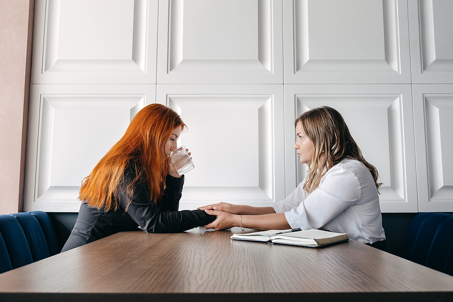 Woman meeting a therapist for emotional trauma healing