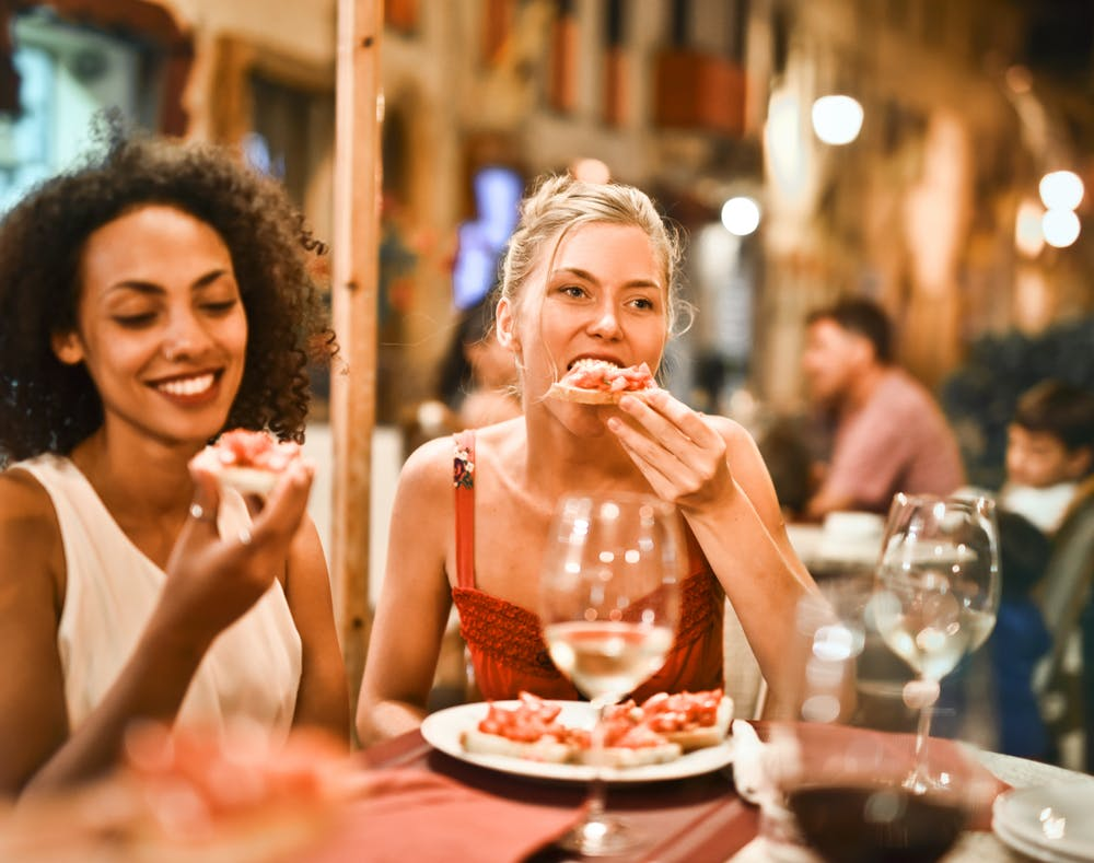 Two woman eating in the best Italian restaurant in Leichhardt