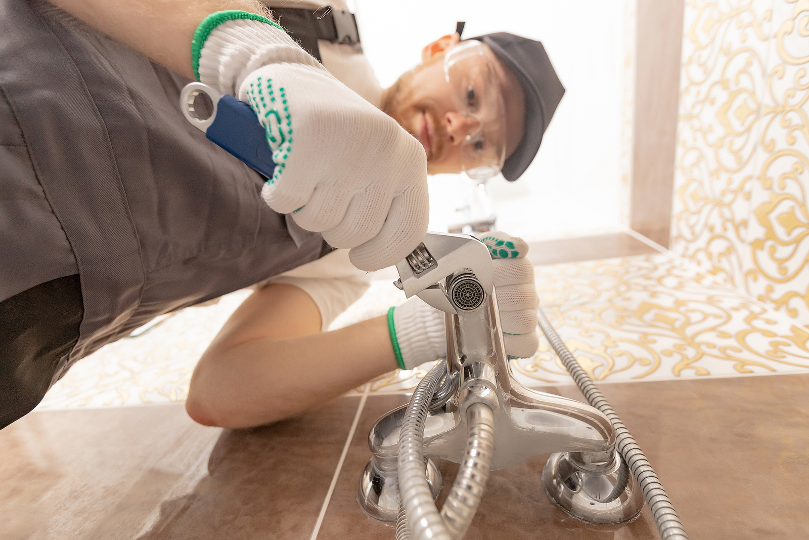 Plumber in Wellington installing a shower stall
