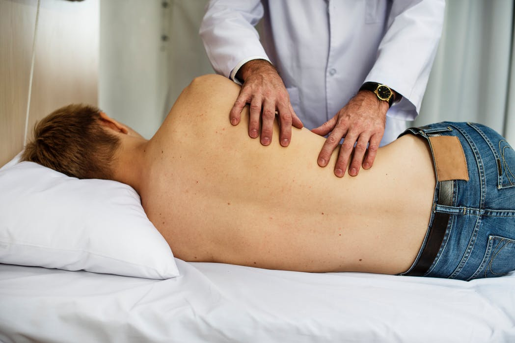 Gold Coast home doctor treating a patient