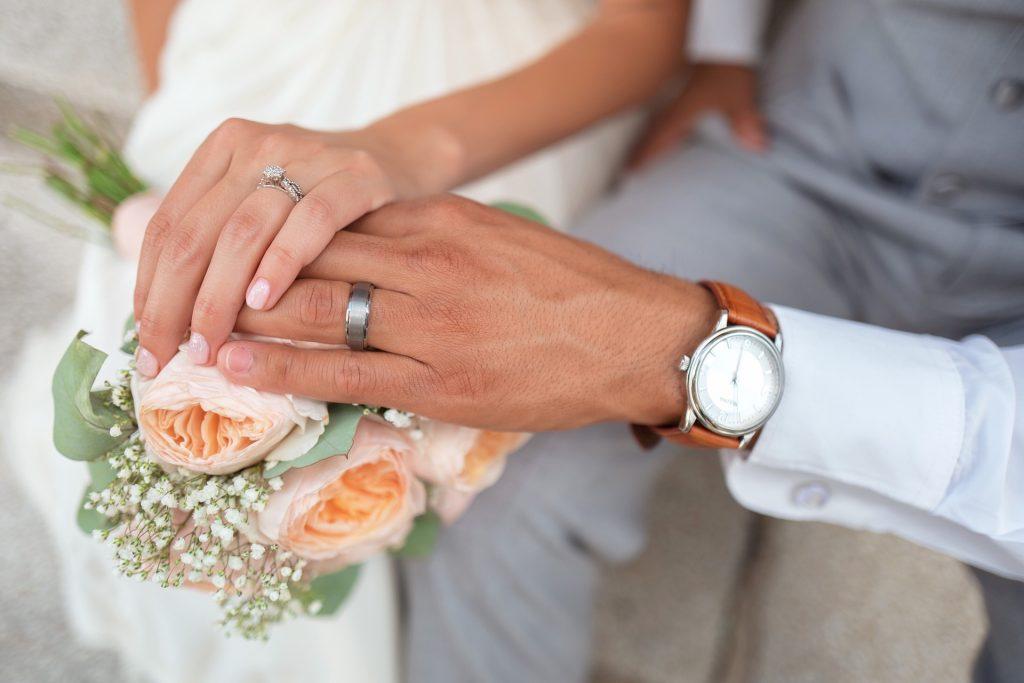 Couple wearing their wedding rings made in Brisbane